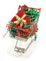 Shopping cart with gifts to illustrate online shopping